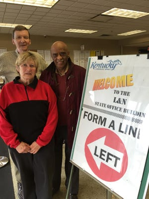 Reps. Mary Lou Marzian, Jim Wayne (center)  and Darryl Owens (right) at the state social service office in Louisville.