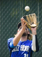 Lake Henry's Caleb Burris gloves a fly ball at the
