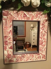 Make a mirror  or picture frame from broken transferware china.