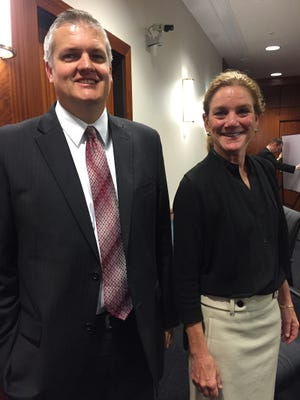 Lawyer Shane C. Sidebottom , left, with client Jacqueline Heyman after reaching a settlement in her favor over her 'whistleblower' claim against state government.