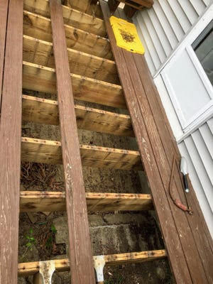 Because of water-related issues, these treated lumber deck joists have developed large cracks.