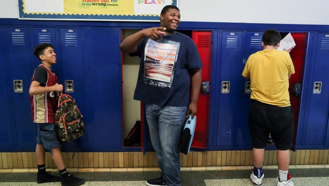 """Kiyaunta Goodwin, 14, grabs his things from his locker at Olmsted Academy North. """"I was bigger than all my classmates in kindergarten,"""" Goodwin said. """"I just want to be as tall as God wants me to be."""" May 24, 2018"""