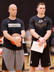 New assistant coach Steve Lutz, left, and graduate