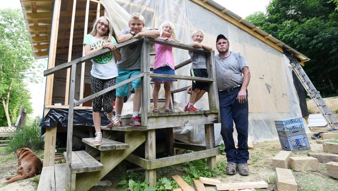 Morgan, 9, Andrew, 11, Parker, 6, and Preston, 7, moved in with their grandparents, John and Tina Barkhurst, after their mother could no longer care for them because of a drug addiction. The Barkhursts are adding on to their Rehoboth home to give each of them their own room.