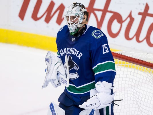 Vancouver Canucks goalie Jacob Markstrom, of Sweden, celebrates after defeating the Edmonton Oilers 3-2 during the third period of an NHL hockey game in Vancouver, British Columbia, Saturday, Oct. 7, 2017. (Darryl Dyck/The Canadian Press via AP)
