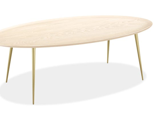 Room & Board's Bailey table, ($499) in a pale finish with brass legs, is modern, but with decorative flourish.