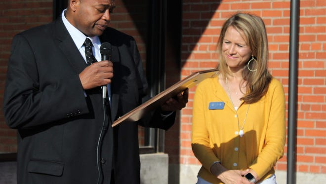 Mayor Anthony Williams proclaimed June 1 as Community Foundation of Abilene Day before a ribbon-cutting outside the new facility on South First Street. With him is Katie Alford, president and CEO of the organization established in the mid-1980s.