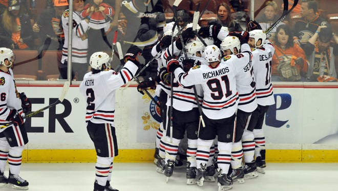 Chicago Blackhawks center Marcus Kruger (16) celebrates with teammates after scoring the game-winning goal against the Anaheim Ducks in the third overtime period in game two of the Western Conference Final of the 2015 Stanley Cup Playoffs at Honda Center.