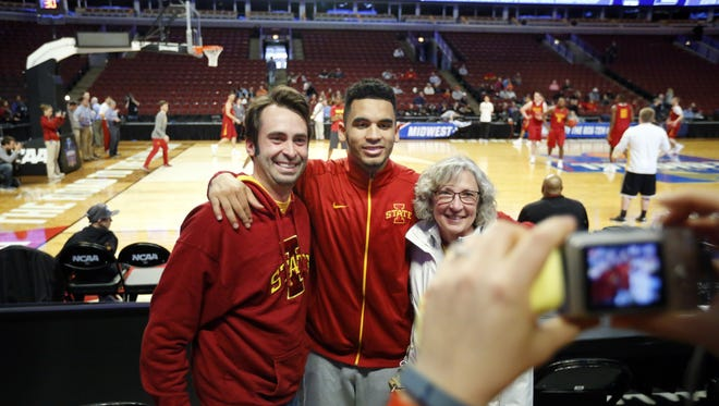 Iowa State's Naz Mitrou-Long takes a photo with Brian Golden and his mother Rhonda during a practice at the United Center in Chicago on Thursday.