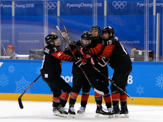 Jillian Saulnier (11), of Canada, celebrates with her teammates after scoring a goal against Finland during the second period of the preliminary round of the women's hockey game at the 2018 Winter Olympics in Gangneung, South Korea, Tuesday, Feb. 13, 2018. (AP Photo/Matt Slocum)