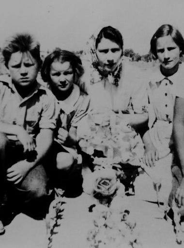 Not too long after the Garrison family moved to California from Arkansas, the youngest girl, Shirley, died of pneumonia. Pictured, the Garrison children gather around her grave in a Potter's Field. It was part of the Tulare cemetery designated for poor people.