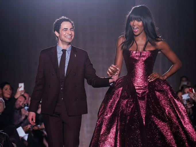 Designer Zac Posen and supermodel Naomi Campbell greet