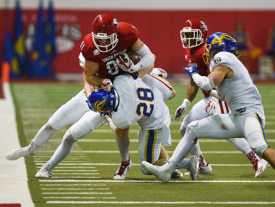 USD Brett Samson is tackled out of bounds by SDSU Chris