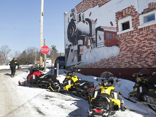 Snowmobilers arrive for lunch at the Clubhouse Restaurant