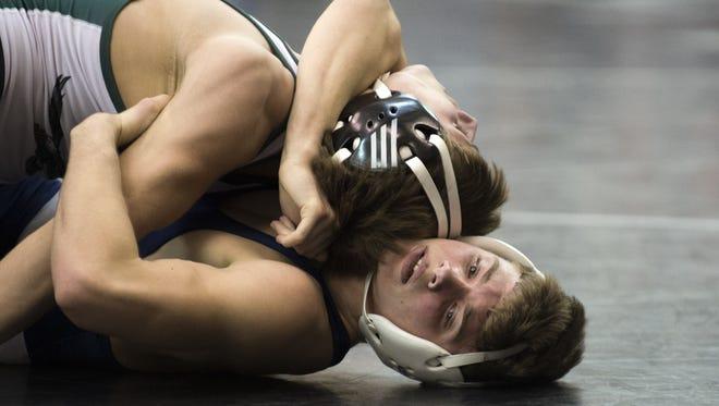 St. Augustine's Steven Schwab, bottom, locks up Dylan Fischer of West Deptford during their 126-pound bout Friday night.
