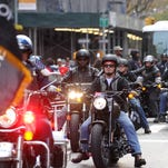 Harley-Davidson employees and veterans ride in the 2015 America's Parade on Veterans Day.