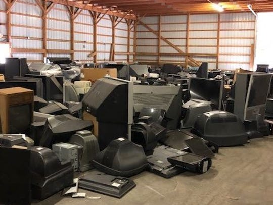Tons of old televisions wait to prepared for recycling