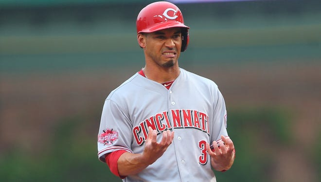 Ivan De Jesus reacts after hitting a double in the first inning against the Cubs.