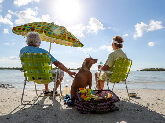 Karen and Tom Farina of Naples enjoy the day at the Bonita Beach Dog Park with their pup, Bruno. With pleasant to warmer days everyone gets to enjoy the water. Dec. 21 is the first day of winter but it will be in the 80s in SWFL all week.