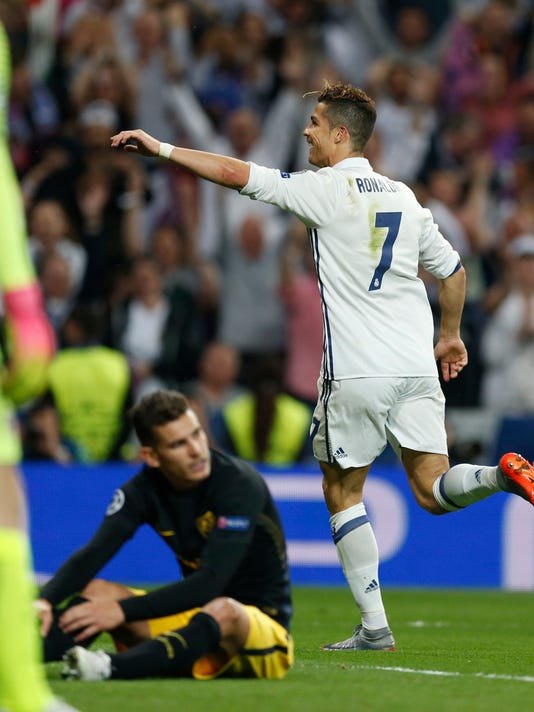 Real Madrid's Cristiano Ronaldo celebrates scoring his side's 3rd goal during the Champions League semifinal first leg soccer match between Real Madrid and Atletico Madrid at the Santiago Bernabeu stadium in Madrid, Spain, Tuesday, May 2, 2017. (AP Photo/Francisco Seco)