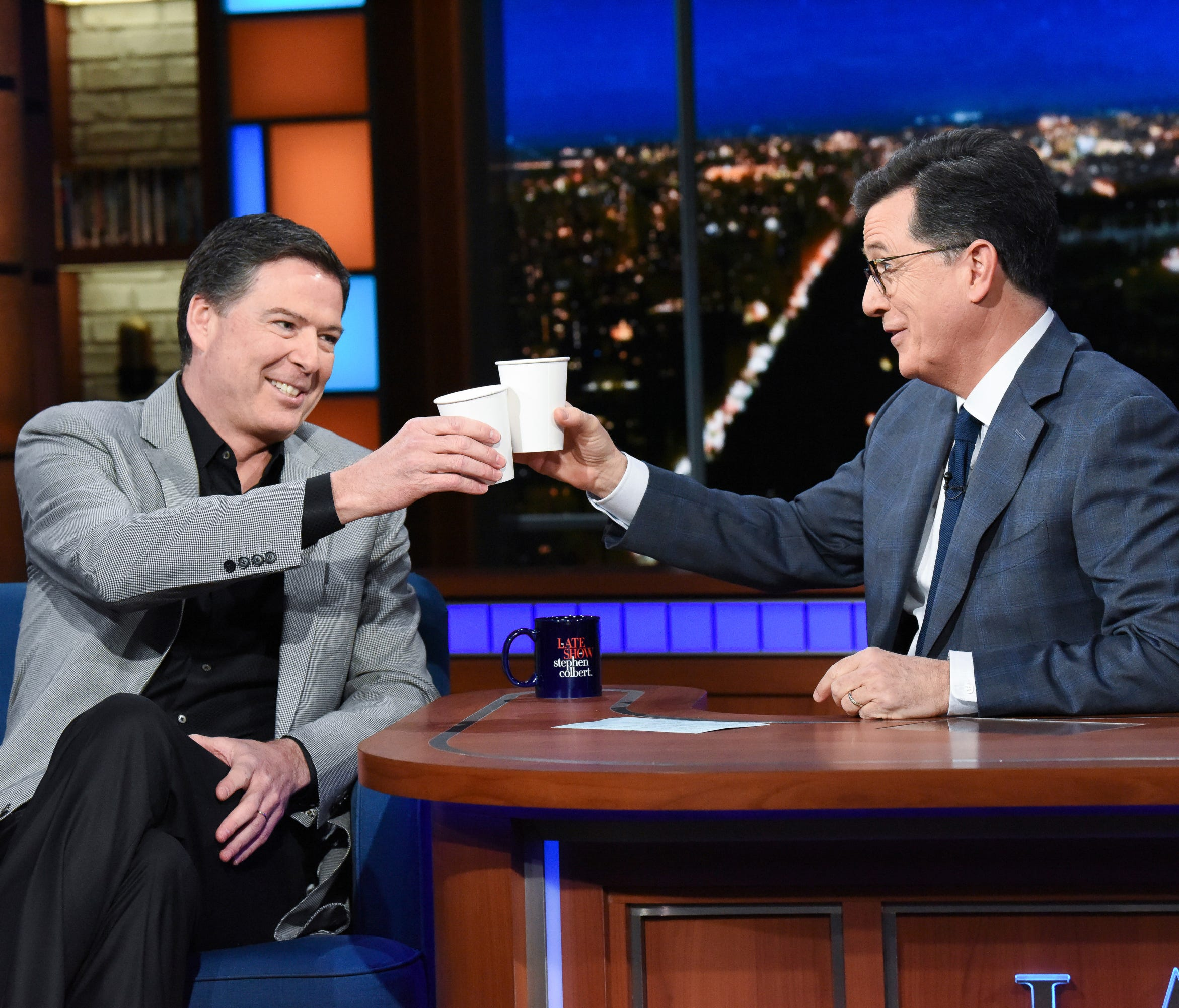 Former FBI director James Comey (left) with host Stephen Colbert (right) on