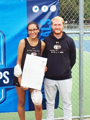 Bethel freshman Daniela Herrera and coach Gabe Johnson celebrate Herrera's singles title at the ITA-NAIA Regionals in Winfield. Herrera plays next weekend at the ITA Nationals in Rome, Ga.