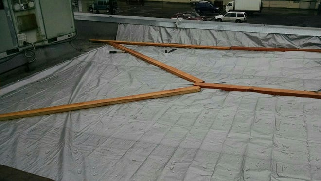 A tarp covers the roof of Mt. Angel City Hall to prevent more leaks.