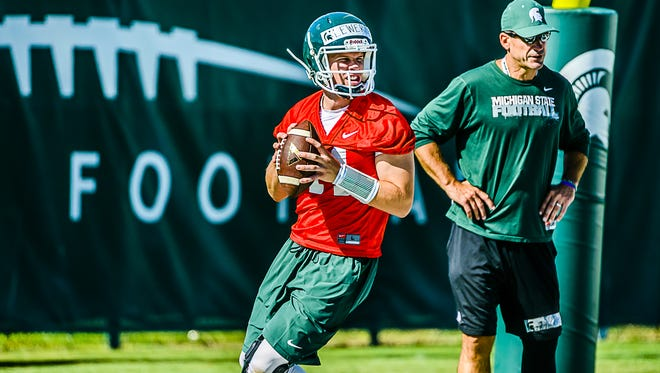 With a young quarterback (Brian Lewerke, right) and youth at wideout and along the offensive line, MSU needs a great season from co-offensive coordinator and primary play caller Dave Warner, right.