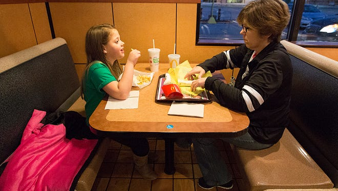 Kidney recipient Natasha Fuller of Oakfield eats in McDonalds in Fond du Lac Tuesday November 7, 2017, with her grandma Chris Burleton. It's a tradition they keep after Natasha's health checkups. Doug Raflik/USA TODAY NETWORK-Wisconsin