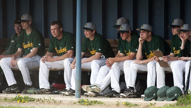 BFA players watch the action from the dugout during a high school baseball game between BFA St. Albans and Burlington at Orrie Jay Field on Saturday.