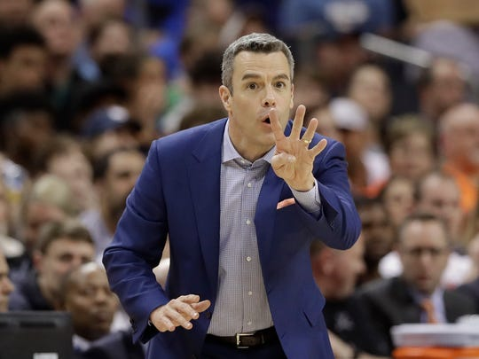 Virginia coach Tony Bennett argues a call during the second half of an NCAA college basketball game against Florida State in the Atlantic Coast Conference tournament in Charlotte, N.C., Friday, March 15, 2019. (AP Photo/Chuck Burton)