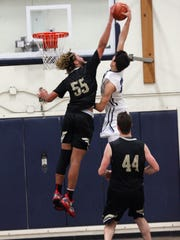Camarillo High's Jaime Jaquez Jr., soaring over Oak Park's Ezekiel Richards during a game this season, was the top scorer in the county in his junior season.