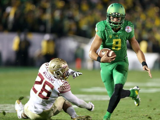 Oregon quarterback Marcus Mariota on the 2014 Ducks football team.