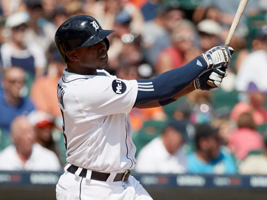 Justin Upton hits a two-run double in the sixth inning against the Astros at Comerica Park on July 30, 2017.