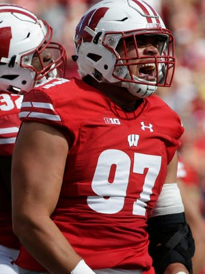 Wisconsin defensive end Isaiahh Loudermilk celebrates his sack.