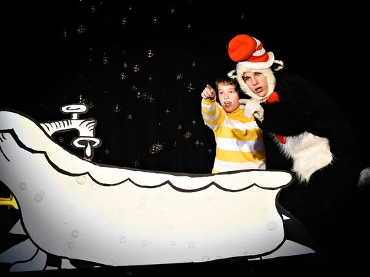 """Spring Grove students Christian Sherwood (JoJo), left, and Seth Shields (Cat in the Hat) perform selected scenes from """"Seussical"""" as students celebrate Dr. Seuss' birthday at Spring Grove High School in Spring Grove,  Wednesday, March 2, 2016. The full musical will be presented four times this weekend. Curtain times are Friday March 4  at 7pm; Saturday March 5 at 2pm and 7pm; and Sunday March 6 at 2pm. Dawn J. Sagert photo"""