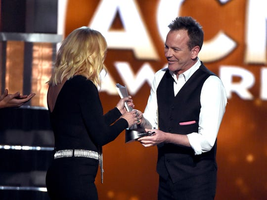Actor/recording artist Kiefer Sutherland presents the Female Vocalist of the Year award to recording artist Miranda Lambert at the 51st Academy of Country Music Awards last month in Las Vegas.
