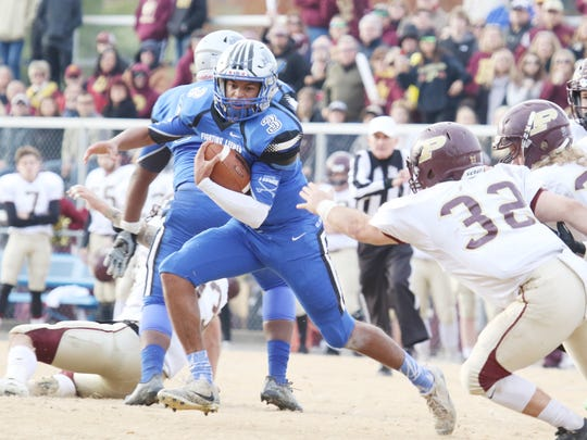 Robert E. Lee quarterback Jayden Williams dodges Poquoson's