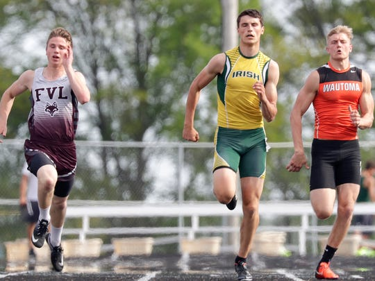 Freedom's Caden Hofacker, center, competes in the 200-meter dash during the Division 2 sectional May 24 in Freedom.
