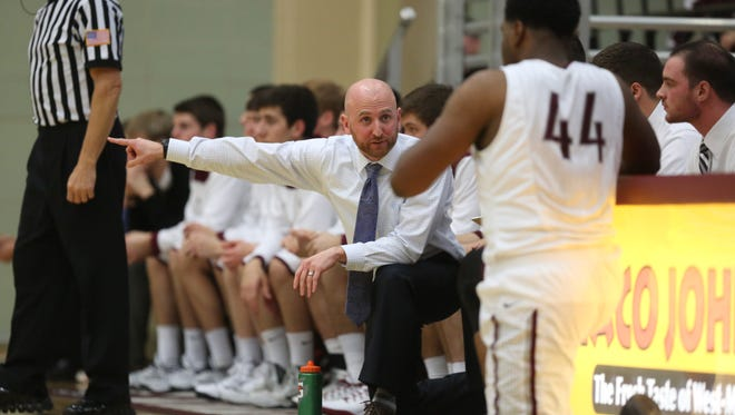 Dowling Catholic coach Mike O'Connor coaches from the bench during a high school basketball game against Dubuque Wahlert at Dowling Catholic High School on Friday, Dec. 5, 2014, in Des Moines, Iowa.
