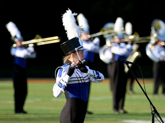 McNary flute player Hayley Guptill performs as the