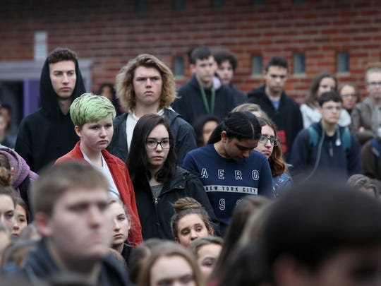 Students at Shasta High School listen as the names of victims from the parkland shooting are read aloud Wednesday at the school in Redding.