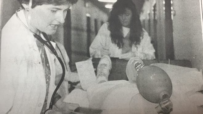 Dr. Debra Wallace gave orders to Angie Gunter, a medical lab technician at Union County Methodist Hospital, as she diagnosed injuries of a victim in a simulated airplane crash behind UCHS in May 1993.