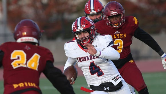 Stepinac's Michael Nicosia (4) looks for some running