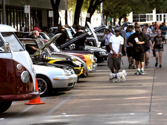 Visitors walk down Cypress Street Thursday during CarWalk. Organizers estimated 120 motor vehicles were on display.