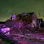 Debris lies on the ground near a home that was heavily damaged by a tornado in Rowlett, Texas, on Saturday. Tornadoes swept through the Dallas area after dark on Saturday evening causing significant damage.