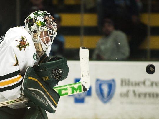 Catamounts goalie Mike Santaguida (1) makes a save during the Hockey East quarterfinal men's hockey game last season.