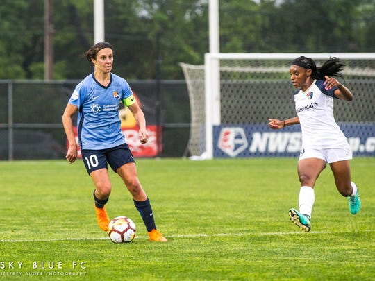 Sky Blue's Carly Lloyd (left) and Courage's Crystal Dunn on Saturday, May 19, 2018.