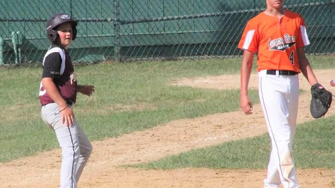 Portsmouth's Porter Lalime looks in the outfield after a basehit during last weekend's New Hampshire Little League District II tournament in Concord.