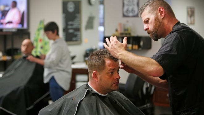 George Miller gives Will Gray a haircut at the Springfield Barbershop & Spa for Men on Wednesday, Apr. 20, 2016.